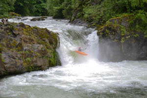 Stephen McGrady boofing the 20 footer on Canyon Creek.