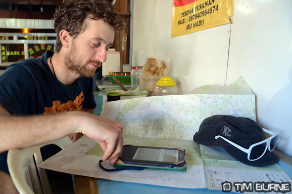 Planning the next river in a roadside cafe (warung)