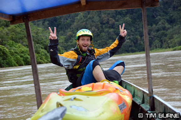 Celebrating survival of the flash flood on the Mamasa river, with a boat ride across the lake to the take-out.