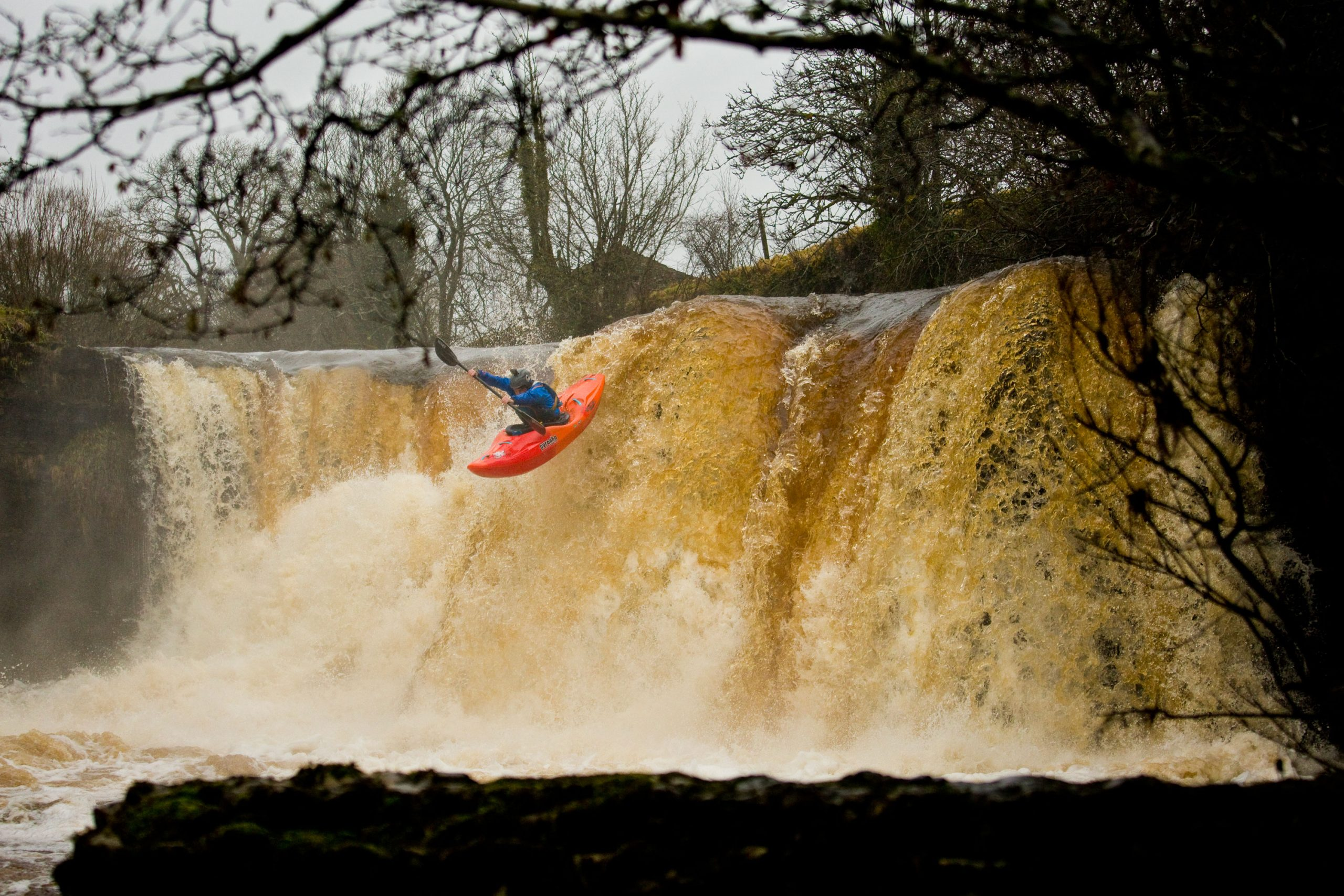 Bren Orton paddling a Scorch Large in Orange Soda